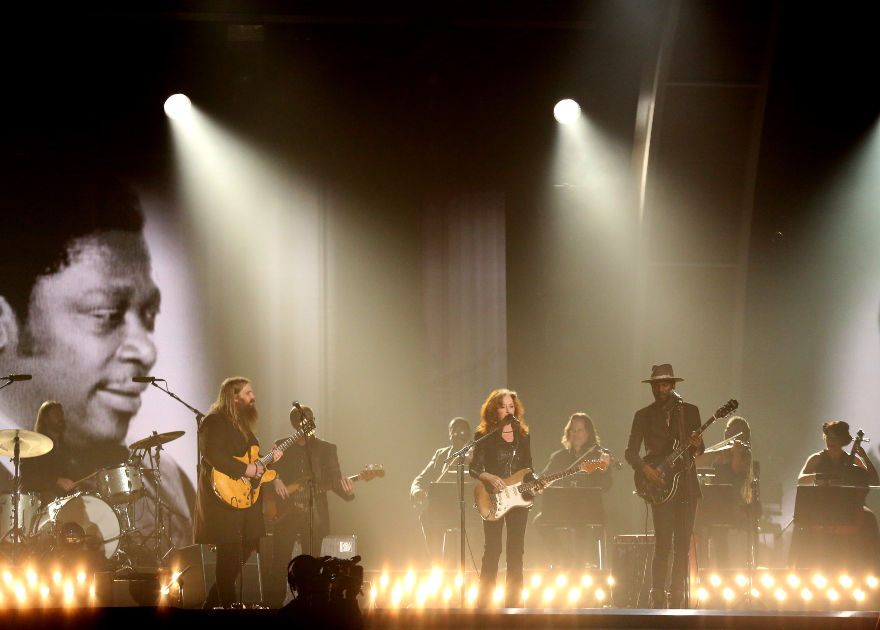 Chris Stapleton, from left, Bonnie Raitt, and Gary Clark Jr. perform a tribute to B.B. King at the 58th annual Grammy Awards on Monday, Feb. 15, 2016, in Los Angeles. (Photo by Matt Sayles/Invision/AP)