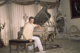 Entertainer Liberace  is seated at his piano in his Beverly Hills home in California on June 17, 1961.    Liberace's home is reported to have 28 rooms.           (AP Photo)