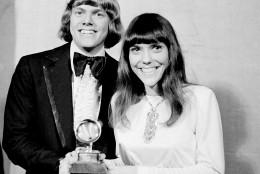 """The Carpenters, Richard and Karen, pose with their Grammy during the 13th annual 1970 Grammy Awards in Los Angeles, Ca., March 17, 1971.  The brother-sister duo was named best new artist of the year, 1970, and also won as the best contemporary duo or group vocalists for """"Close to You.""""  (AP Photo)"""