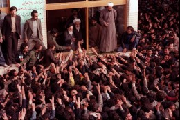 The late Ayatollah Ruhollah Khomeini, center, is greeted by supporters after arriving at the airport in Tehran Iran in this Feb. 1, 1979 photo. Monday Feb. 1, 1999 is the 20th anniversary of Khomeini's return from exile to lead the Islamic revolution in his country.  ( AP Photo )
