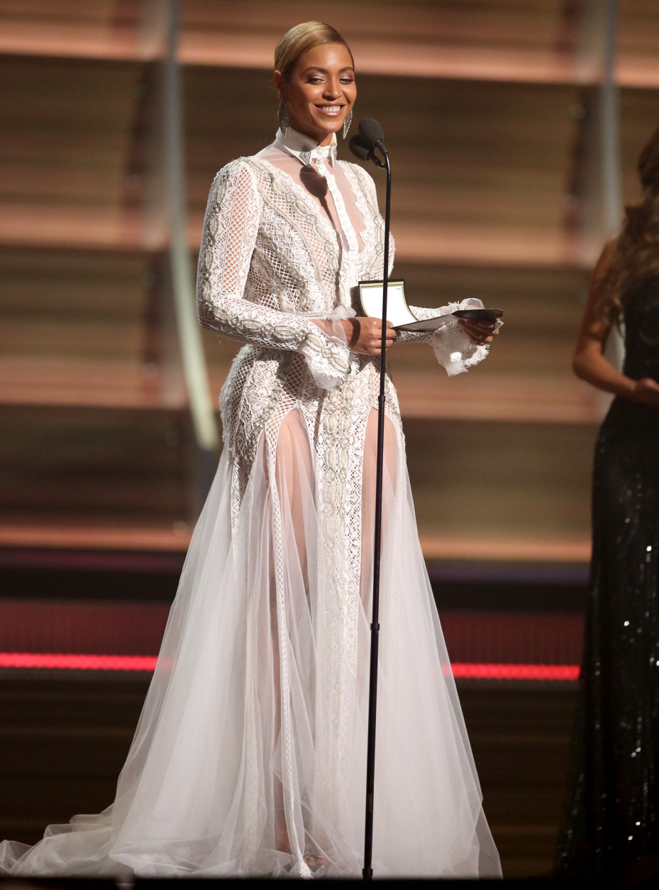 Beyonce presents the award for record of the year at the 58th annual Grammy Awards on Monday, Feb. 15, 2016, in Los Angeles. (Photo by Matt Sayles/Invision/AP)