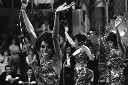 "FILE -In this Jan. 21, 1968 file photo, The Supremes with Diana Ross, front, Cindy Birdsong and Mary Wilson dance with their arms in the air as they perform at the annual ""Bal pare"" party in Munich, West Germany. Ross, Wilson and the Florence Ballard made up the first successful configuration of the group. Cindy Birdsong replaced Ballard in 1967. Wilson, now 70, reminisced in an interview with Associated Press on June 12, 2014, about a major milestone: the 50th anniversary of the Supremes first No. 1, million-selling song, ""Where Did Our Love Go"" - released June 17, 1964.  (AP Photo/Frings, file)"