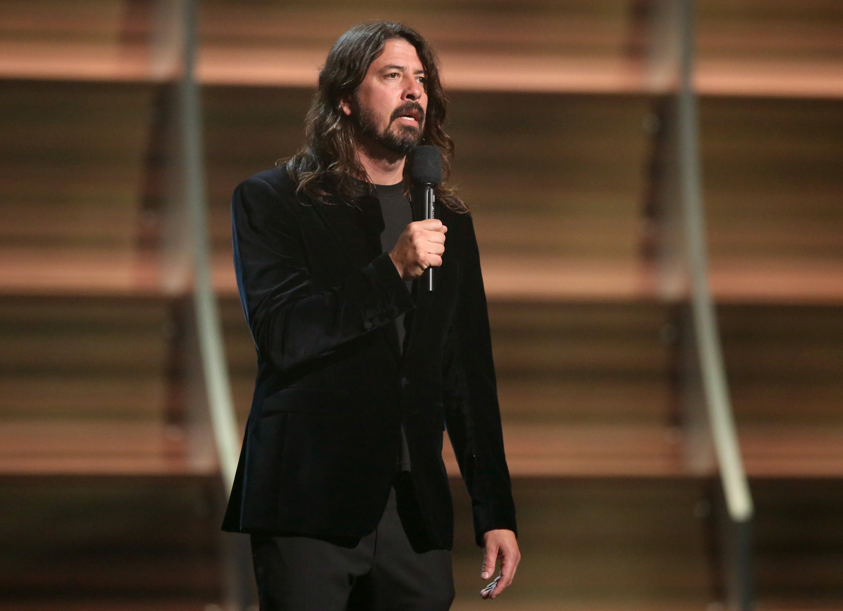 Dave Grohl introduces a performance by Hollywood Vampires at the 58th annual Grammy Awards on Monday, Feb. 15, 2016, in Los Angeles. (Photo by Matt Sayles/Invision/AP)