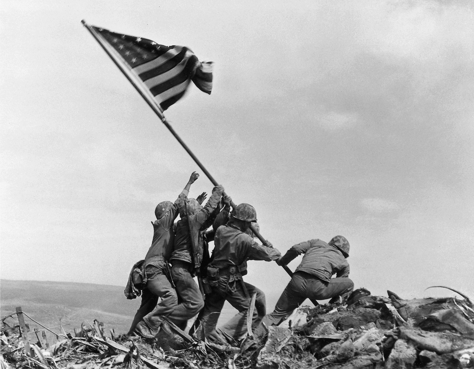 FILE - In this Feb. 23, 1945, file photo, U.S. Marines of the 28th Regiment, 5th Division, raise a U.S. flag atop Mount Suribachi, Iwo Jima. Two Gastonia, N.C., men, Joseph Tedder, 90, and Mack Drake, 89, fought alongside more than 70,000 Marines, sailors and airmen on Iwo Jima, a tiny 8-square mile speck of volcanic rock and sand midway between Guam and Tokyo, during the closing months of World War II. (AP Photo/Joe Rosenthal, File)