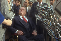 Wheelchair-bound Hustler publisher Larry Flynt is surrounded by reporters outside the U.S. Supreme Court building in Washington December 2, 1987.  In a lawsuit filed by the Rev. Jerry Falwell, the Supreme Court sided with Flynt, who claimed a First Amendment right to parody Falwell in his magazine. (AP Photo/Charles Tasnadi)