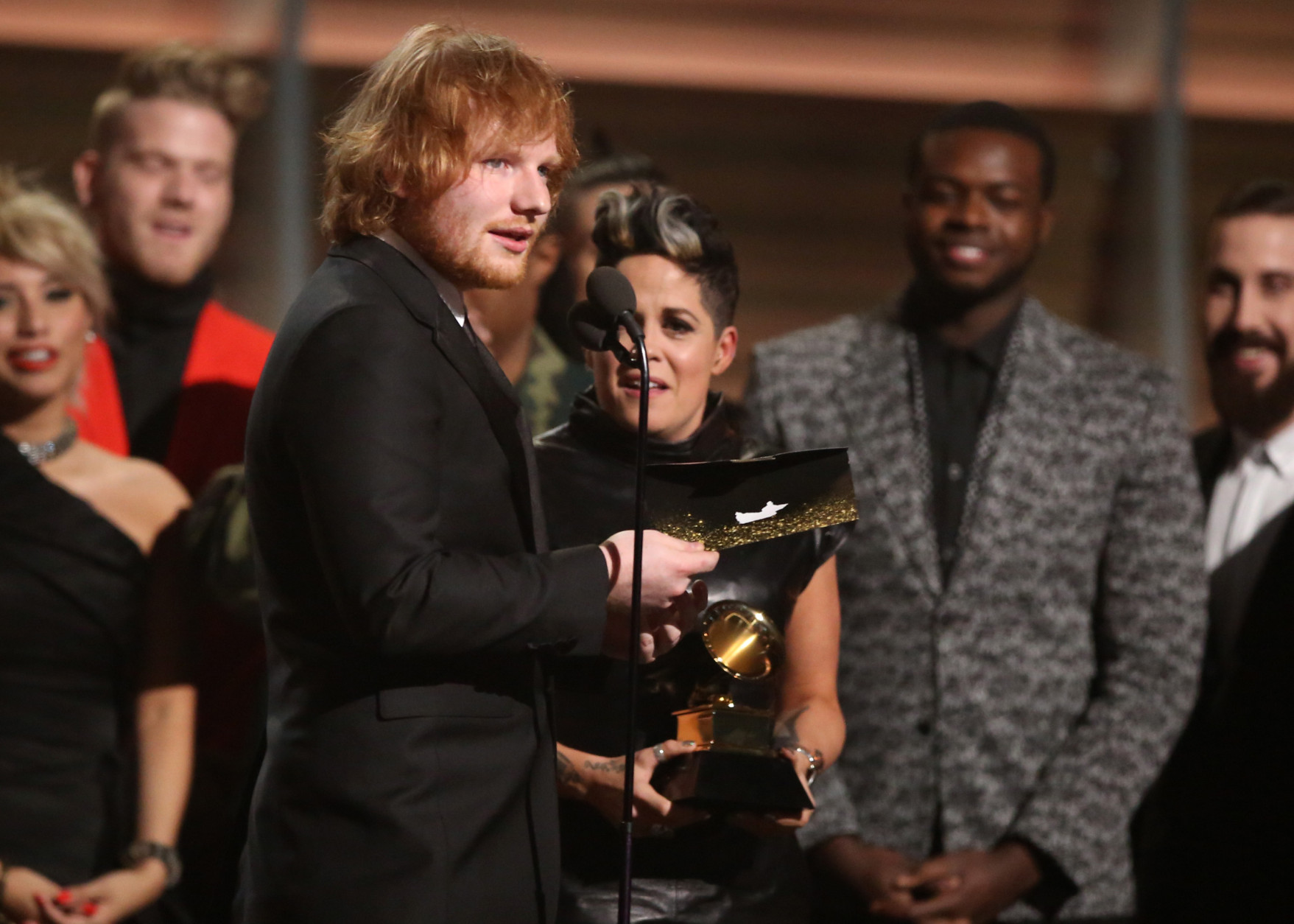 "Ed Sheeran accepts the award for song of the year for ""Thinking Out Loud"" at the 58th annual Grammy Awards on Monday, Feb. 15, 2016, in Los Angeles. (Photo by Matt Sayles/Invision/AP)"