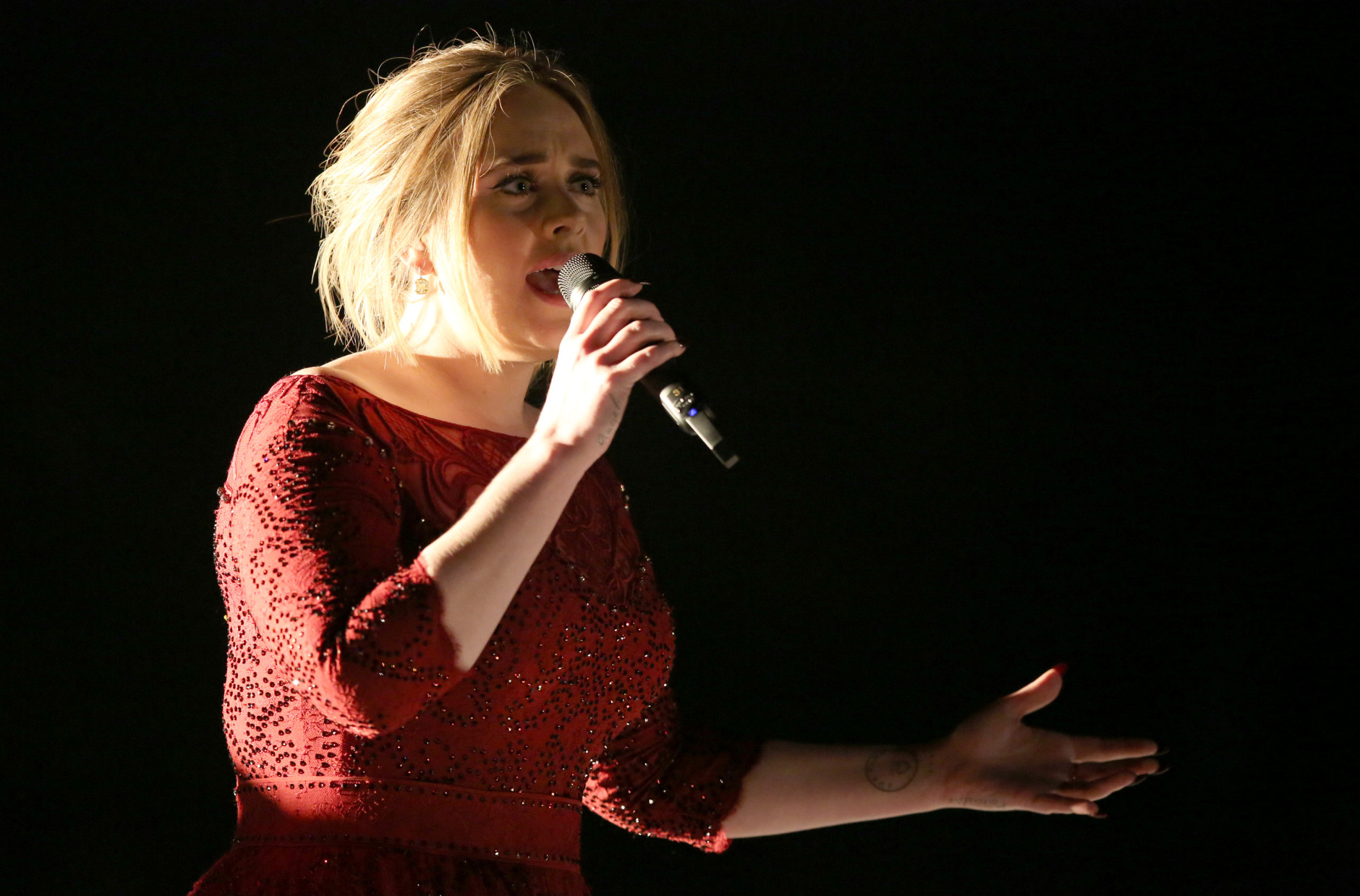 Adele performs at the 58th annual Grammy Awards on Monday, Feb. 15, 2016, in Los Angeles. (Photo by Matt Sayles/Invision/AP)