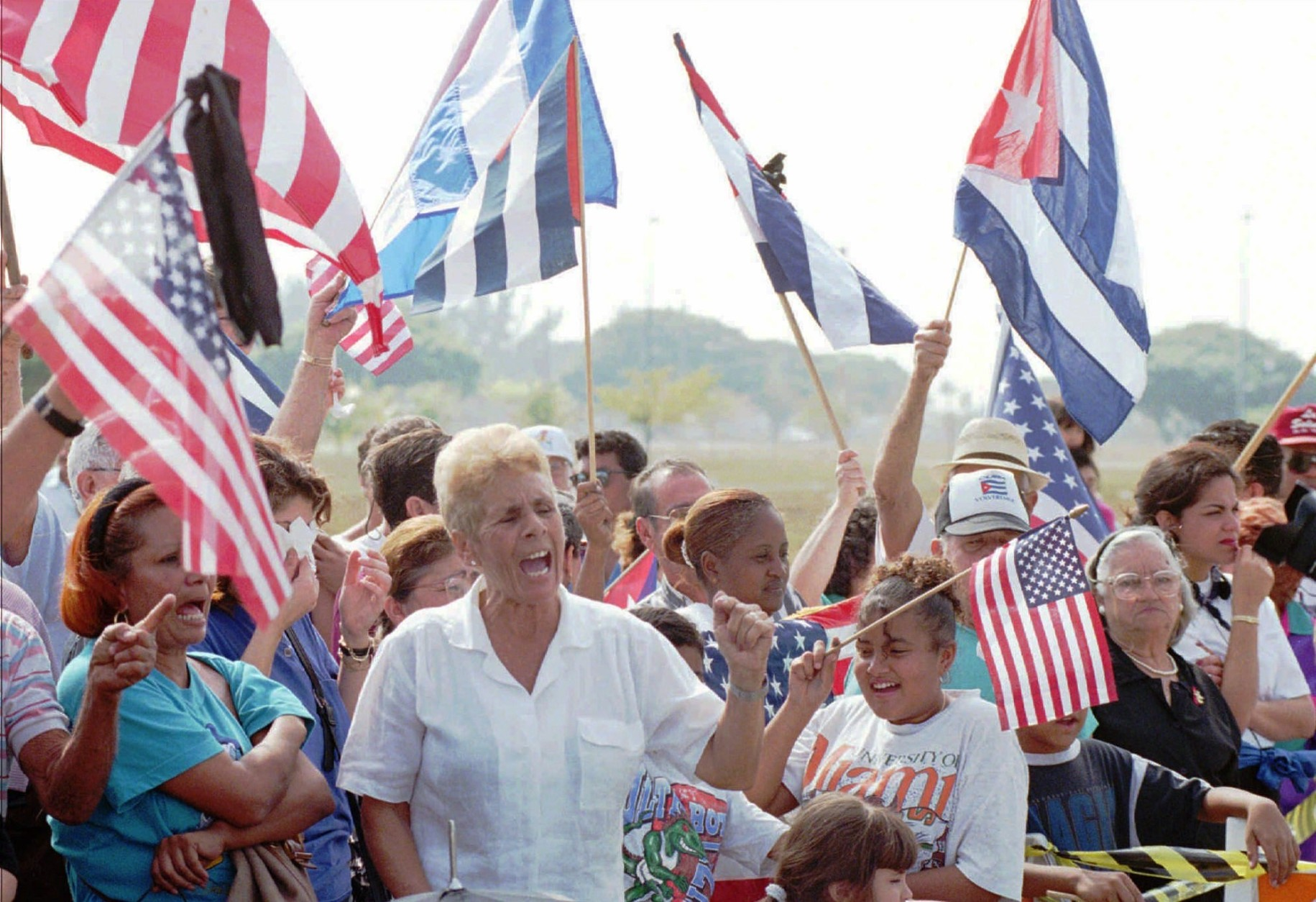 Anti-Castro demonstrators shout for the liberation of Cuba at the Opa-locka, Fla., airport, Sunday, Feb. 25, 1996 where they gathered to show their outrage at the shooting down of two Brothers to the Rescue aircraft Saturday. (AP Photo/Tannen Maury)