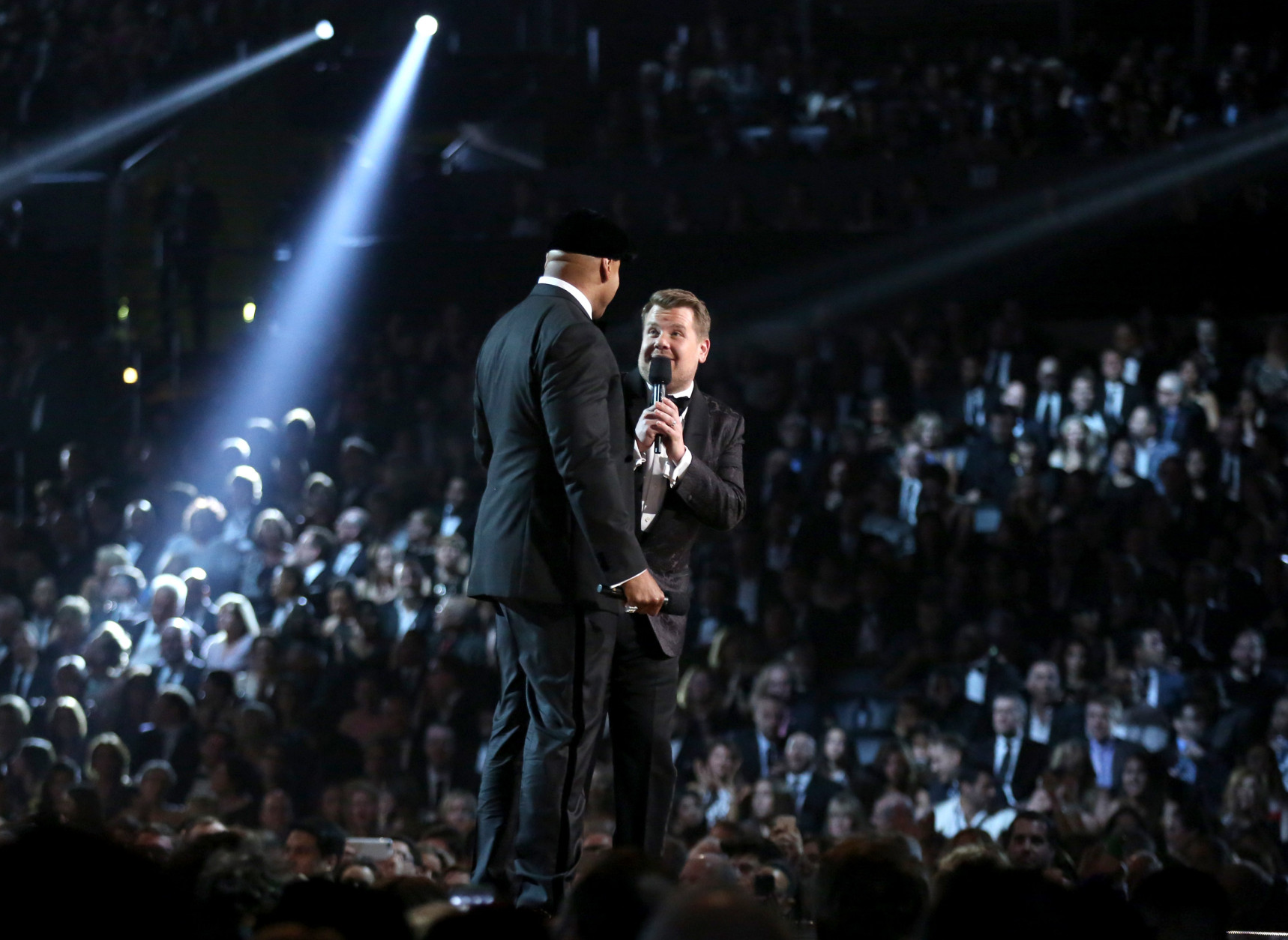 LL Cool J, left, and James Corden introduce a tribute to Lionel Richie at the 58th annual Grammy Awards on Monday, Feb. 15, 2016, in Los Angeles. (Photo by Matt Sayles/Invision/AP)