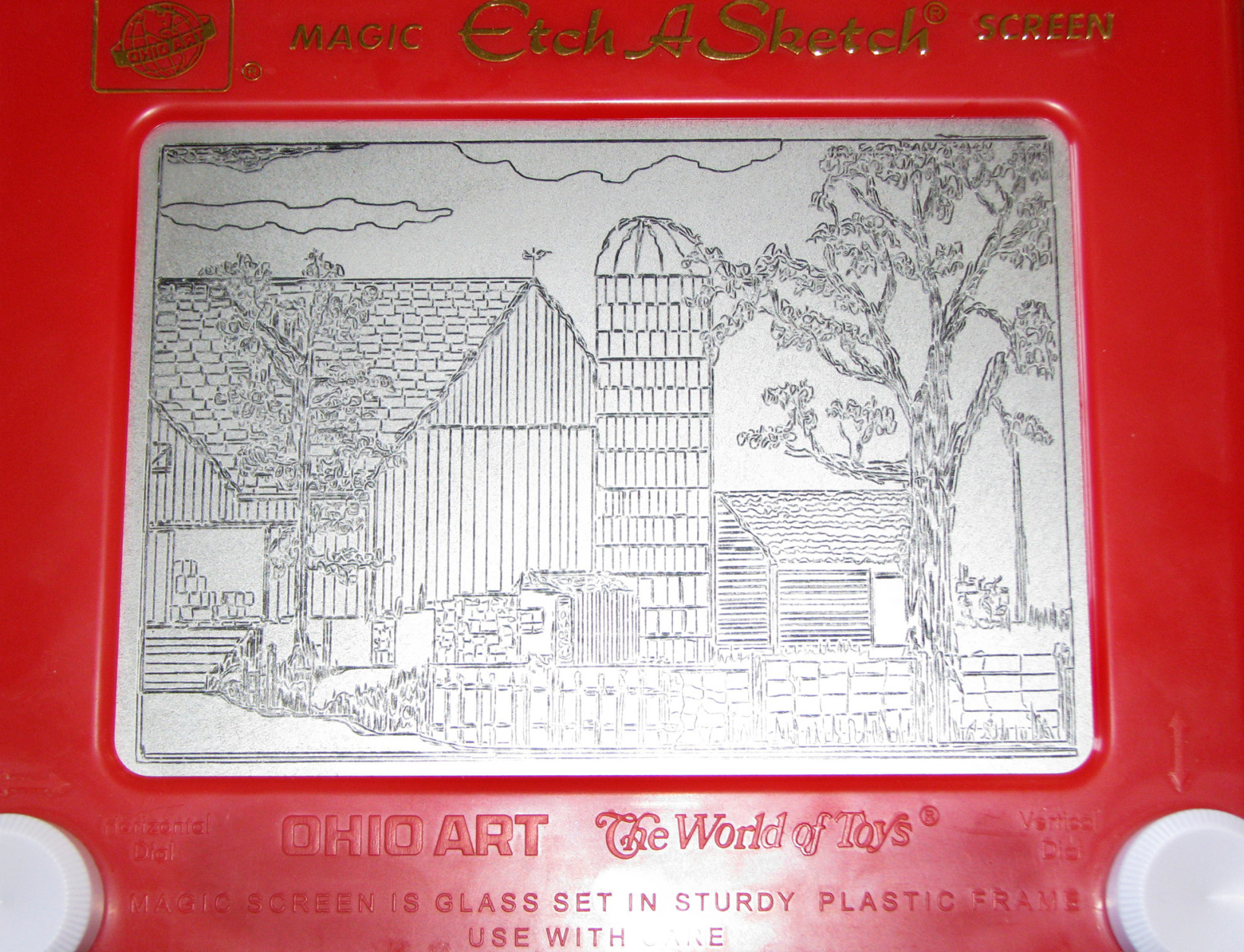 FILE - In this June 26, 2008 file photo, an Etch-A-Sketch drawing made by artist Andy Kingston depicts a rural farm scene in Poplar Bluff, Mo. Ohio Art Co. sold the Etch A Sketch and the spinoff Doodle Sketch to Spin Master Corp. for an undisclosed price to a toy firm in Toronto. Ohio Art announced the surprise move Thursday, Feb. 11, 2016. (Margaret Harwell/The Daily American Republic via AP) MANDATORY CREDIT