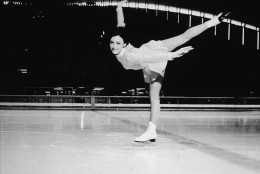 American figure skater Peggy Fleming executes a spiral on the ice rink at the 1968 Winter Olympic Games, where she won the gold medal in the women's figure skating event on February 11, Grenoble, France, February 1968. (Photo by Hulton Archive/Getty Images)