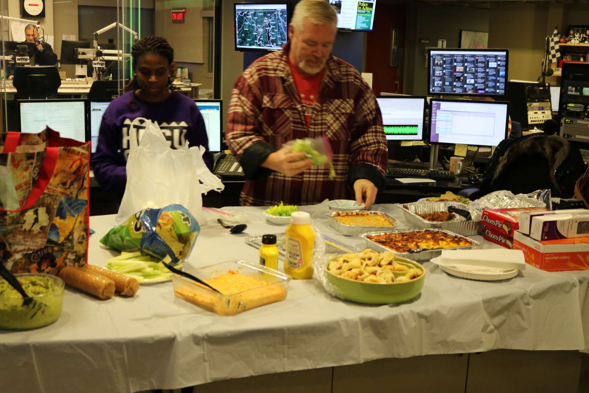 WTOP's Jack Taylor samples snacks from the table. (WTOP/Hanna Choi)
