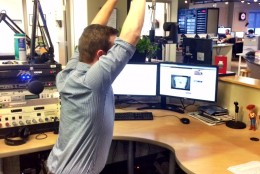 Get rid of your chair for a few minutes and try chair pose instead. WTOP Entertainment Editor Jason Fraley demonstrates. (WTOP/Rachel Nania)