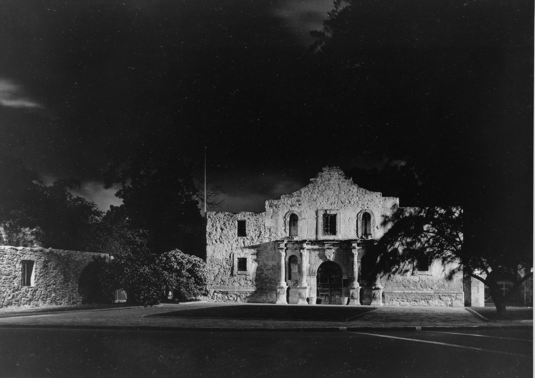 """FILE - In this Feb. 22, 1936 file photo, the chapel of Alamo, site of an heroic battle during the Texan war of independence from Mexico, is seen at nighttime in San Antonio. Built in the 18th century by Spanish missionaries looking to convert the local Native Americans, the Alamo gained its place in history in 1836, when about 200 Texas settlers died trying to defend the fort from Mexican forces. Among the dead: Davy Crockett, Jim Bowie and Lt. Col. William Travis, who promised never to surrender or retreat. The battle cry, """"Remember the Alamo!"""" helped inspire Texans to defeat the Mexican army a month later, securing Texas's independence. (AP Photo, File)"""