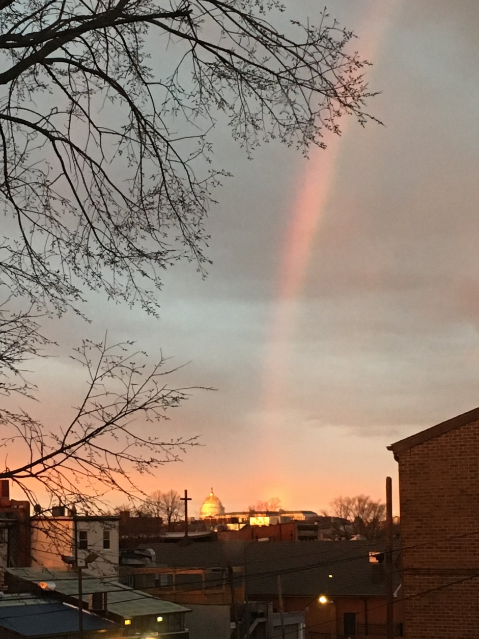 A rainbow at the Capitol, as seen frmo Northeast D.C. (midwestgal via Twitter)