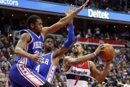 Philadelphia 76ers guard Hollis Thompson, left, and forward Nerlens Noel (4) defend Washington Wizards guard Ramon Sessions (7) during the second half of an NBA basketball game, Friday, Feb. 5, 2016, in Washington. The Wizards won 106-94. (AP Photo/Alex Brandon)