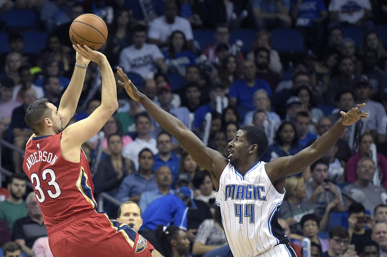 New Orleans Pelicans forward Ryan Anderson (33) goes up for a shot in front of Orlando Magic forward Andrew Nicholson (44) during the first half of an NBA basketball game in Orlando, Fla., Monday, Dec. 28, 2015. (AP Photo/Phelan M. Ebenhack)