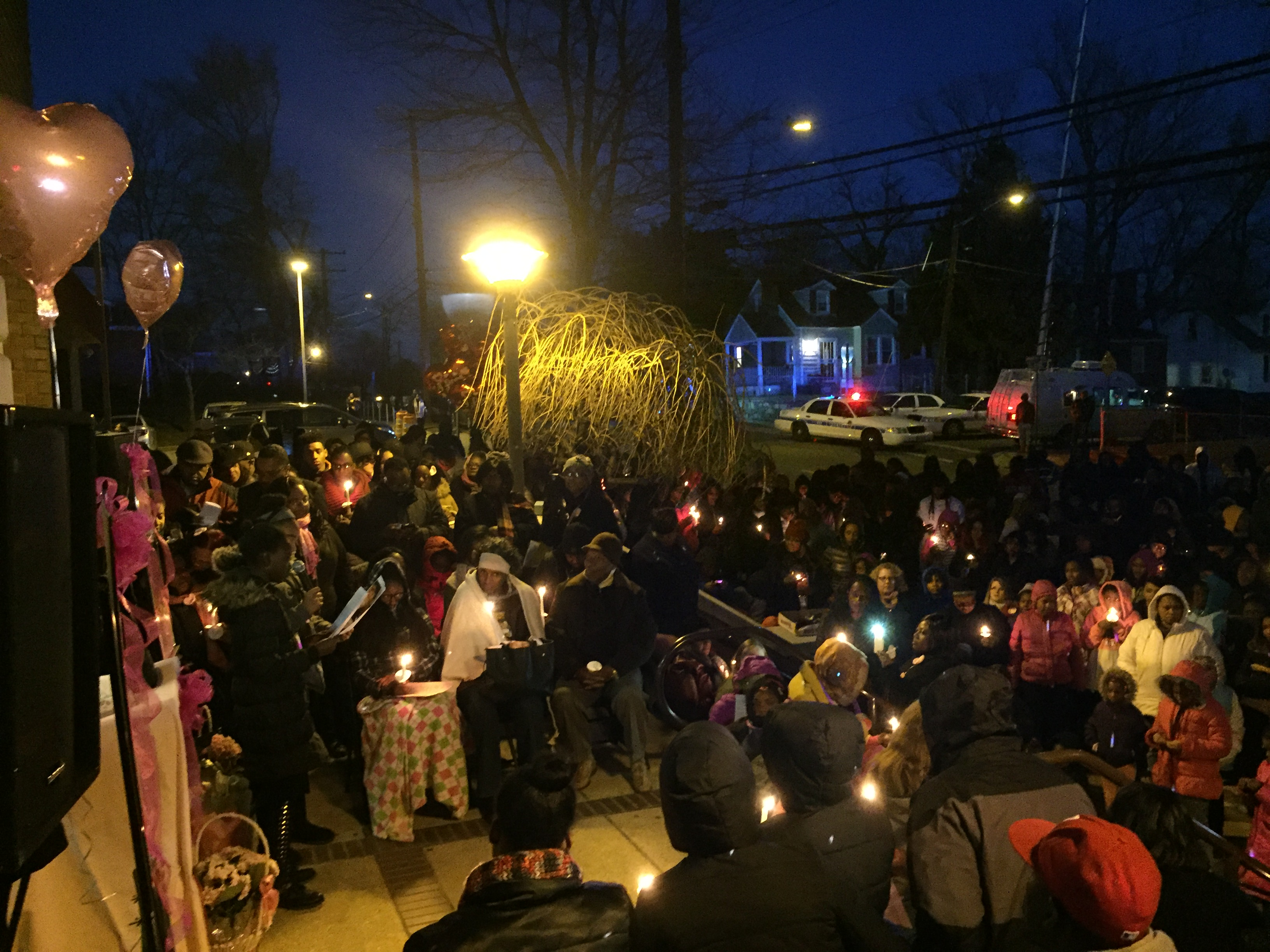 Vigil held for slain teacher and her young daughter