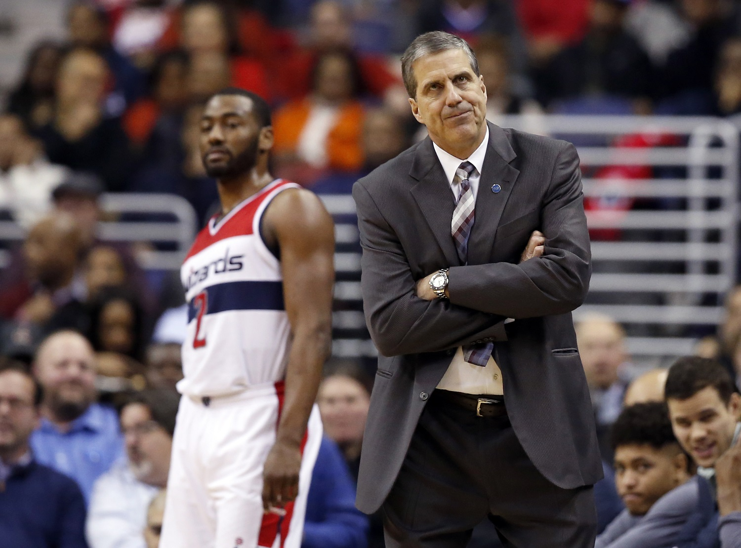 Washington Wizards head coach Randy Wittman reacts with Washington Wizards guard John Wall (2) behind him, in the first half of an NBA basketball game against the Miami Heat, Wednesday, Jan. 20, 2016, in Washington. (AP Photo/Alex Brandon)
