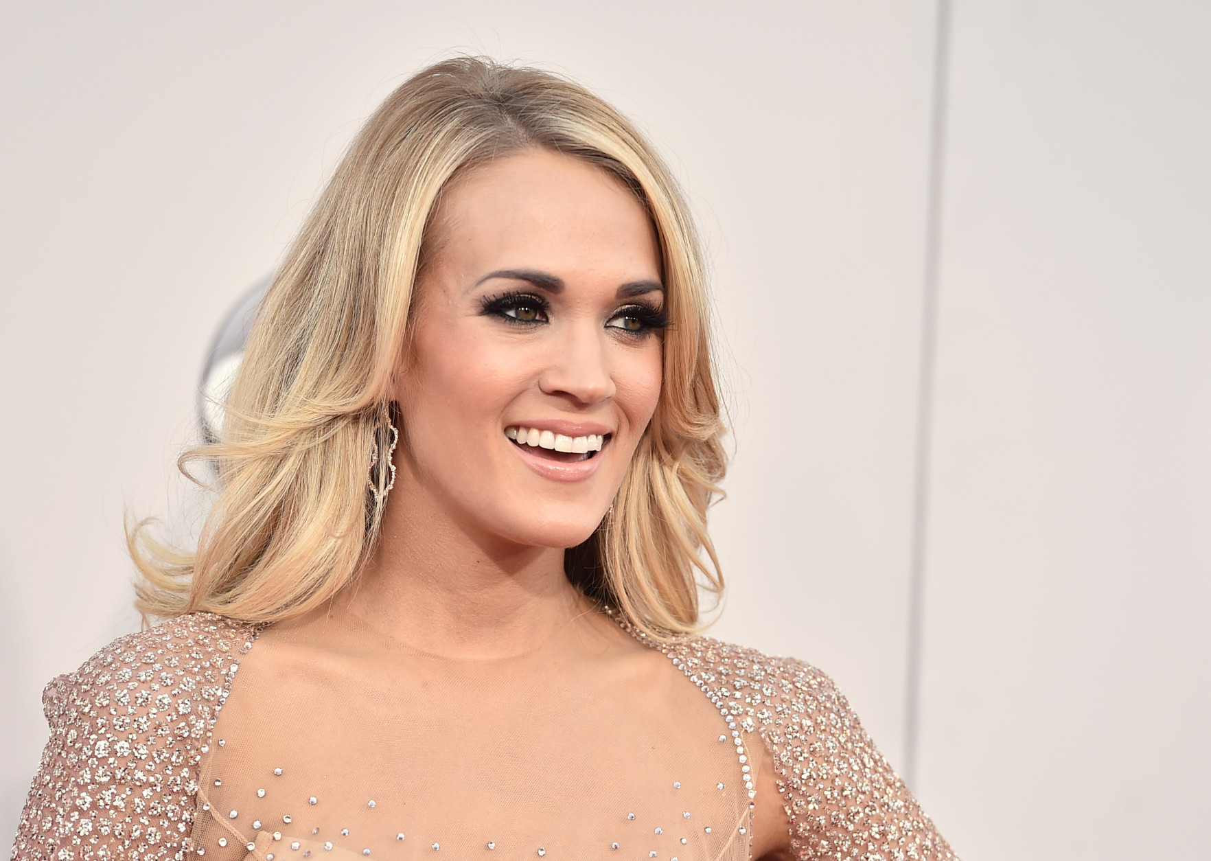 Carrie Underwood arrives at the American Music Awards at the Microsoft Theater on Sunday, Nov. 22, 2015, in Los Angeles. (Photo by Jordan Strauss/Invision/AP)