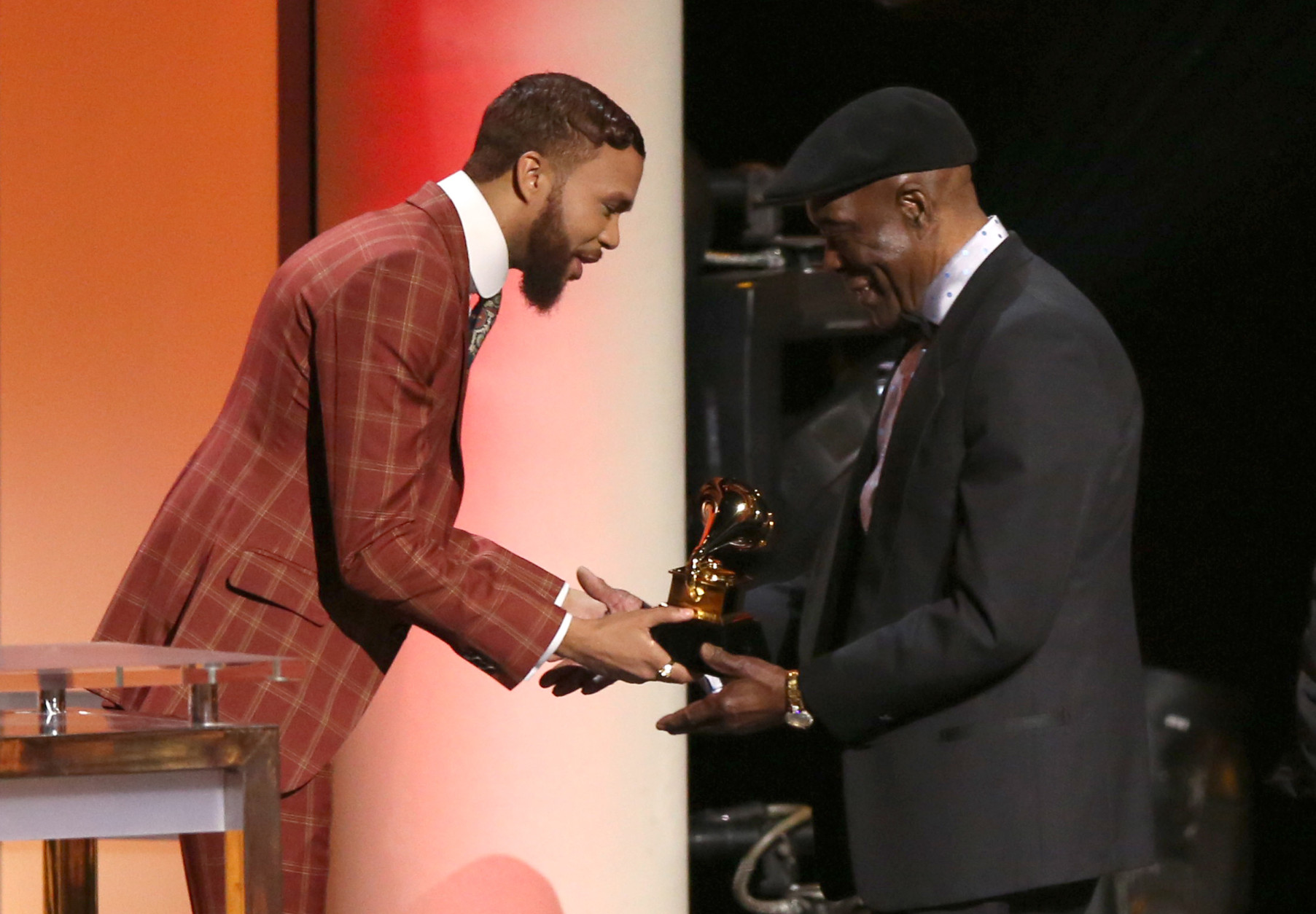 "Jidenna, left, presents the award for blues album to Buddy Guy for ""Born to Play Guitar "" at the 58th annual Grammy Awards on Monday, Feb. 15, 2016, in Los Angeles. (Photo by Matt Sayles/Invision/AP)"