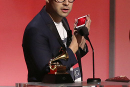 Jack Antonoff calls Taylor Swift as he accepts their award for pop vocal album at the 58th annual Grammy Awards on Monday, Feb. 15, 2016, in Los Angeles. (Photo by Matt Sayles/Invision/AP)