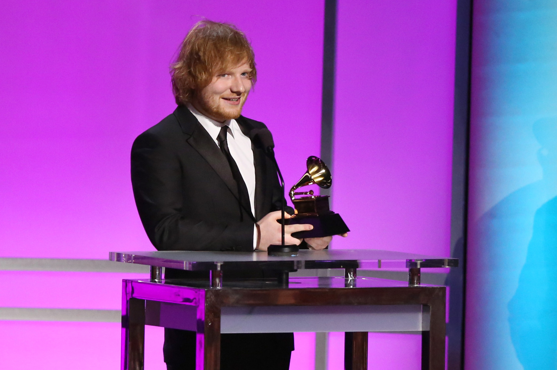 "Ed Sheeran accepts the award for best pop solo performance for ""Thinking Out Loud"" at the 58th annual Grammy Awards on Monday, Feb. 15, 2016, in Los Angeles. (Photo by Matt Sayles/Invision/AP)"