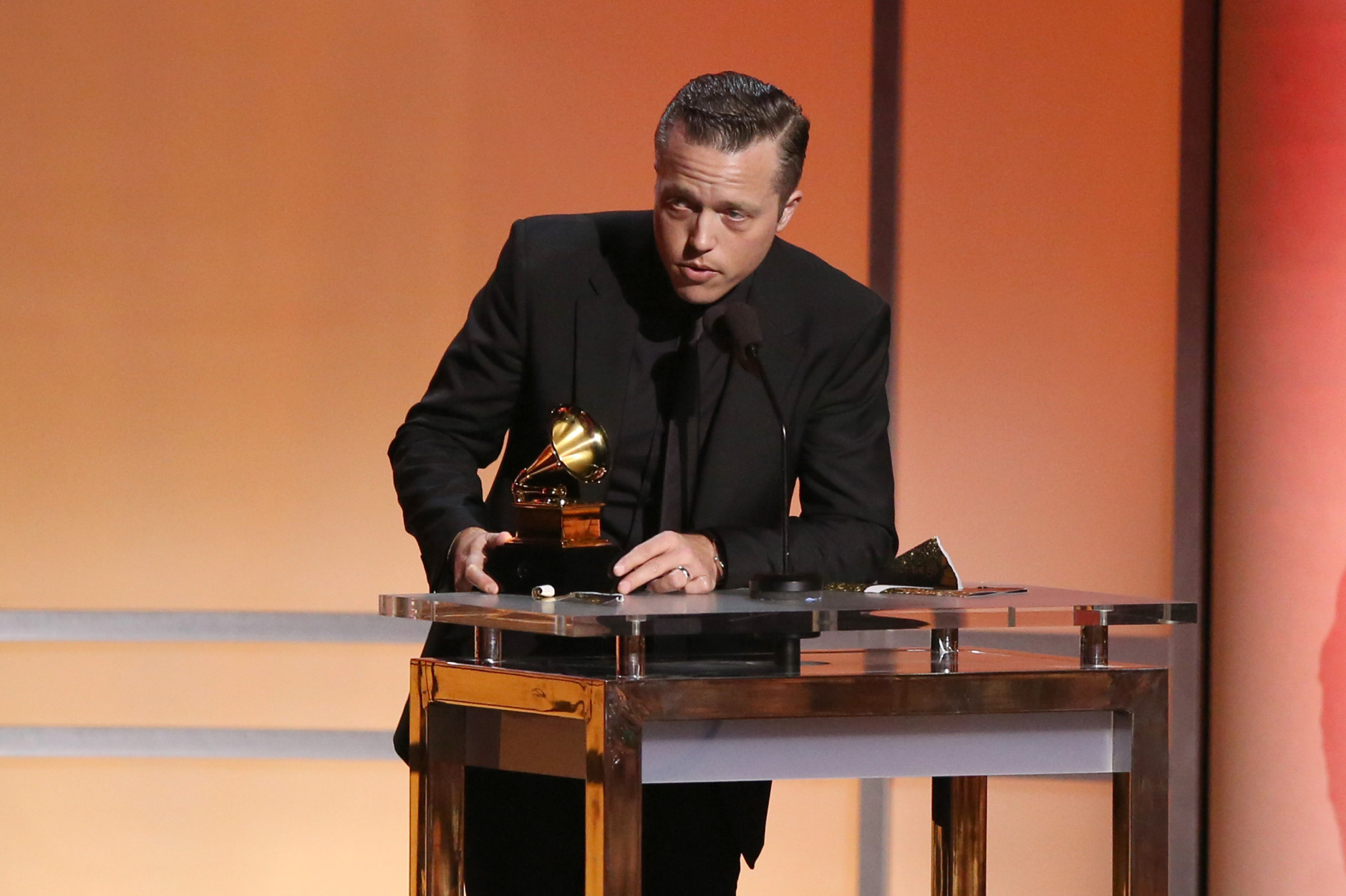 "Jason Isbell accepts the award for best americana album for ""Something More Than Free"" at the 58th annual Grammy Awards on Monday, Feb. 15, 2016, in Los Angeles. (Photo by Matt Sayles/Invision/AP)"