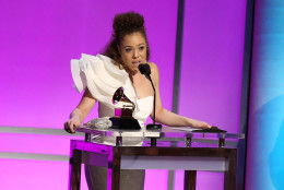 "Kendra Foster accepts the award for best R&B song for ""Really Love"" at the 58th annual Grammy Awards on Monday, Feb. 15, 2016, in Los Angeles. (Photo by Matt Sayles/Invision/AP)"
