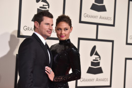 Nick Lachey, left, and Vanessa Lachey arrive at the 58th annual Grammy Awards at the Staples Center on Monday, Feb. 15, 2016, in Los Angeles. (Photo by Jordan Strauss/Invision/AP)