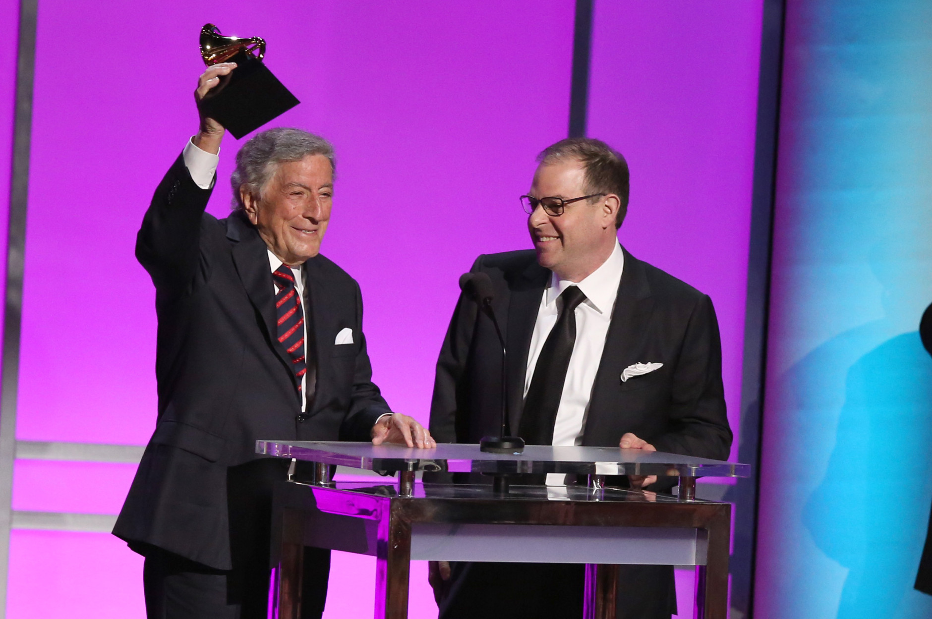 "Tony Bennett, left, and Bill Charlap accept the award for best traditional pop vocal album for ""The Silver Lining: The Songs of John Kern"" at the 58th annual Grammy Awards on Monday, Feb. 15, 2016, in Los Angeles. (Photo by Matt Sayles/Invision/AP)"