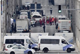 Police and rescue teams are pictured outside the metro station Maelbeek in Brussels, Tuesday, March 22, 2016. Explosions, at least one likely caused by a suicide bomber, rocked the Brussels airport and its subway system Tuesday, prompting a lockdown of the Belgian capital and heightened security across Europe. (AP Photo/Martin Meissner)