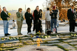 On the 40th anniversary of the assassination of President John F. Kennedy in Dallas, visitors pay their respects at Kennedy's gravesite in Arlington National Cemetery in Arlington, Va., Saturday, Nov. 22, 2003. Members of the slain president's family visited in private at dawn before the cemetery was opened to the public.  (AP Photo/J. Scott Applewhite)