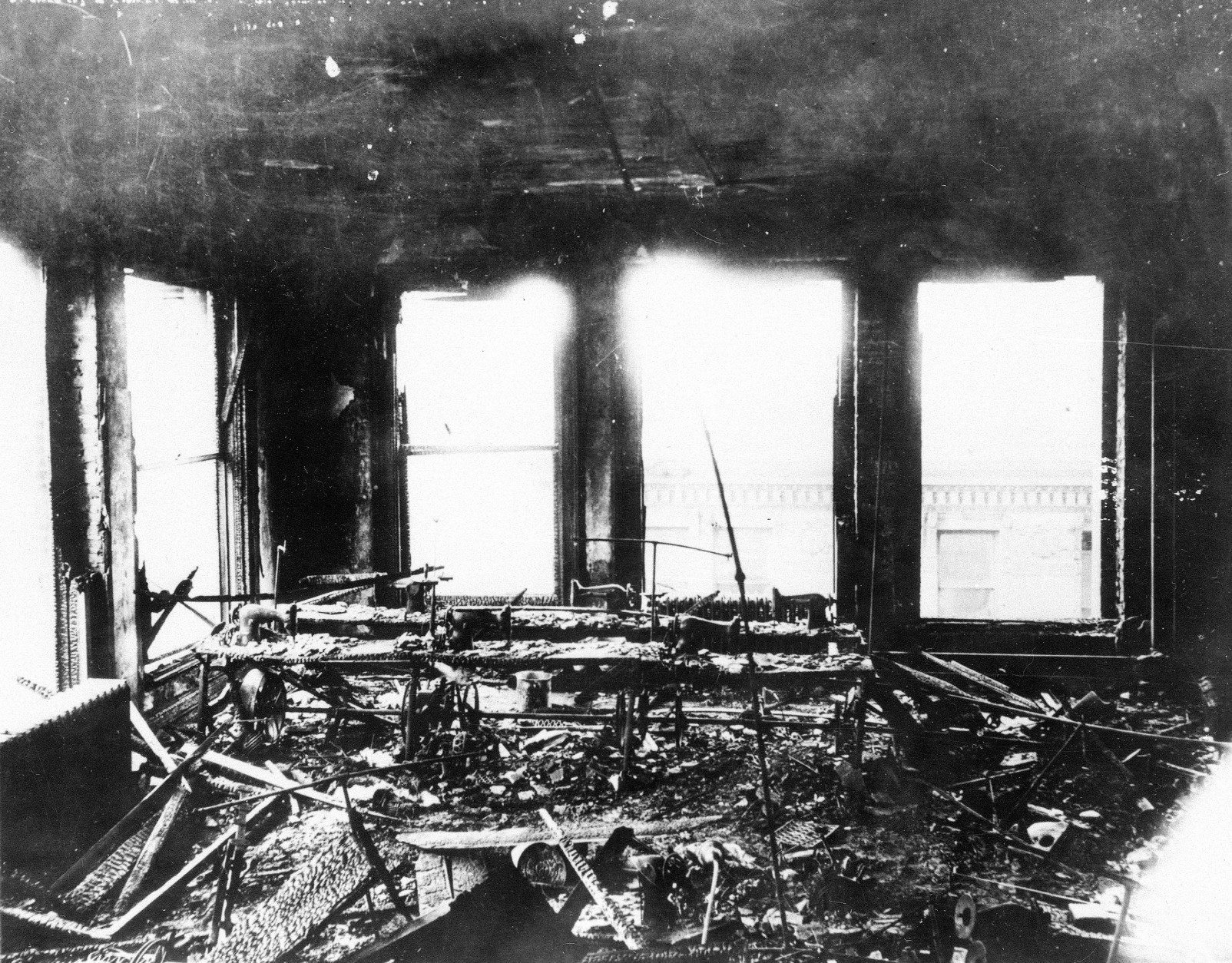 This is a 1911 photo of the charred work room of the Triangle Shirtwaist Company in the Asch building in New York City after a fire engulfed the building.  (AP Photo)