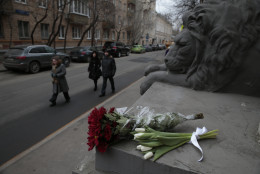 Flowers are placed outside the embassy of Belgium, in Moscow, Russia, Tuesday, March 22, 2016. Authorities in Europe have tightened security at airports, on subways, at the borders and on city streets after deadly attacks Tuesday on the Brussels airport and its subway system. (AP Photo/Pavel Golovkin)