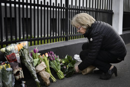 Chairman of the Danish Parliament, Pia Kjaersgaard, with flowers for the victims of the Brussels attacks, at the Belgium Embassy in Copenhagen Tuesday, March 22, 2016. Bombs exploded at the Brussels airport and one of the city's metro stations Tuesday, killing and wounding dozens of people, as a European capital was again locked down amid heightened security threats. The Islamic State group claimed responsibility for the attacks. (Philip Davali/POLFOTO via AP)  DENMARK OUT