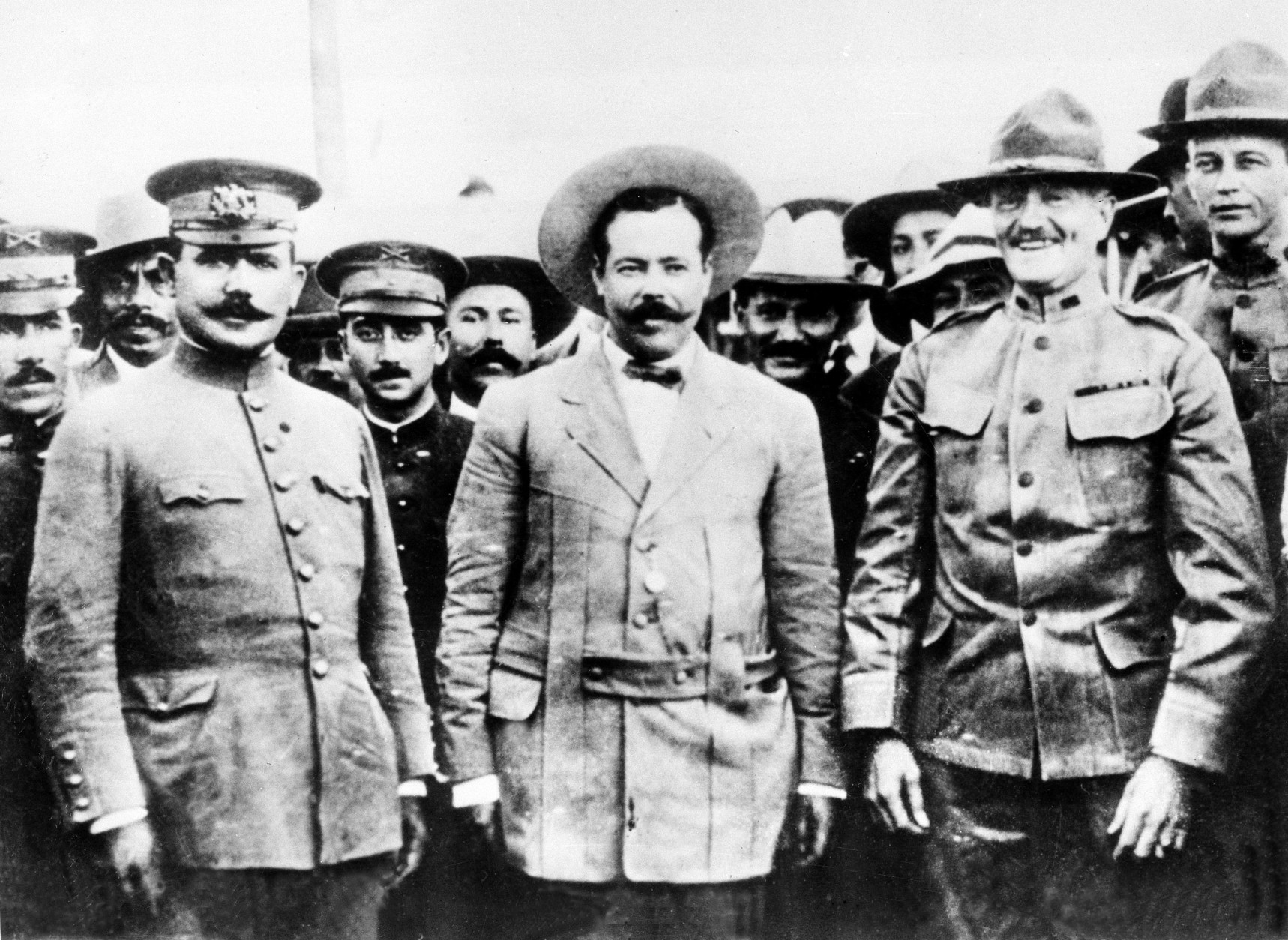 This picture, taken at the border at Nogales, Ariz., in 1916, shows, from left, Gen. Alvaro Obregon, Gen. Pancho Villa and Gen. John J. Pershing in a friendly meeting.  (AP Photo)