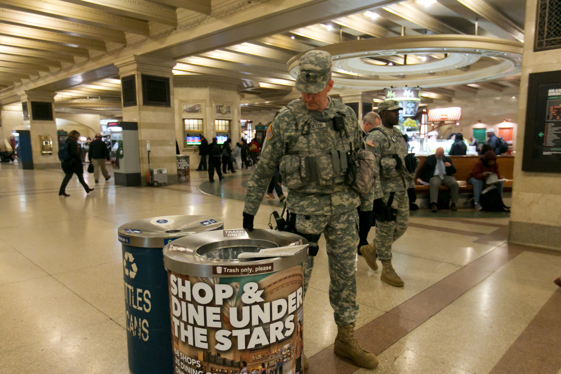 New York Army National Guard Staff Sgt. Rueter, foreground, of Joint Task Force Empire Shield, patrols the lower concourse of Grand Central Terminal, in New York,  Tuesday, March 22, 2016. Authorities are increasing security throughout New York City following explosions at the airport and subway system in the Belgian capital of Brussels.  (AP Photo/Richard Drew)