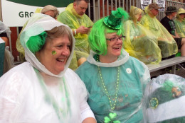 Sarah Griffenhagen, left,  and her sister, Becky Hudgins, wear rain ponchos as light rain falls during the St. Patrick's Day parade in Savannah, Georgia, Thursday, March 17, 2016. Thousands celebrate the Irish holiday each year in Savannah, where Irish immigrants held the city's first St. Patrick's parade in 1824. (AP Photo/Russ Bynum)