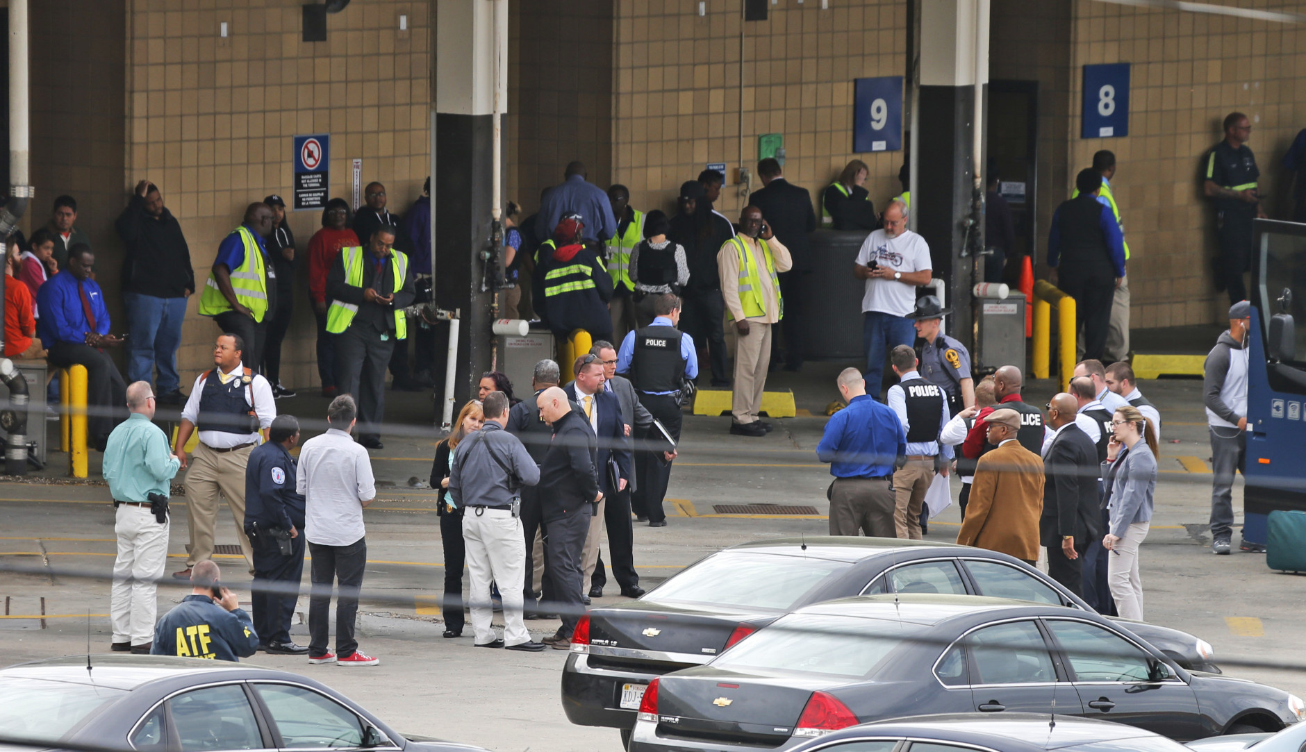 Police and rescue officials gather outside the Greyhound Bus Station Thursday, March 31, 2016, in Richmond, Va. Virginia State Police say two troopers responding to a shooting at the Richmond bus station and a civilian have been taken to a hospital. A police spokeswoman says the shooting suspect was in custody. (AP Photo/Steve Helber)