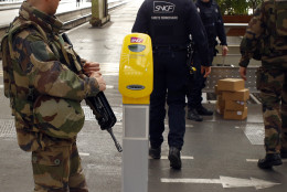 French soldiers check unattended boxes left on the platform at Gare De Lyon railway station in Paris, France, Tuesday, March 22, 2016. Authorities are tightening security at airports and on the streets of European cities after attacks on the Brussels airport and subways system that killed at least one person and injured many others. (AP Photo/Francois Mori)