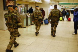 French soldiers patrol in the subway entrance station in Paris, France, Tuesday, March 22, 2016. Authorities are tightening security at airports and on the streets of European cities after attacks on the Brussels airport and subways system that killed at least one person and injured many others. (AP Photo/Francois Mori)
