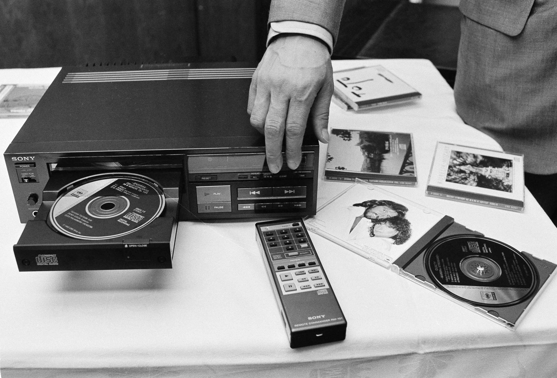 Sony's compact digital audio disc, 4.75-inches in diameter, is loaded into a laser disc cd player during a demonstration for the press in Tokyo, Japan, Aug. 31, 1982. The system, developed by Sony with the Dutch Philips, uses a laser beam to read the music on the compact disc, on which information is stored digitally. No conventional stylus is used. The manufacturer claims superior sound reproduction. It will appear on the Japanese market in October at about $700, an in the U.S. and Europe market a year later. In the foreground is a remote control unit for the player. (AP Photo/Katsumi Kasahara)