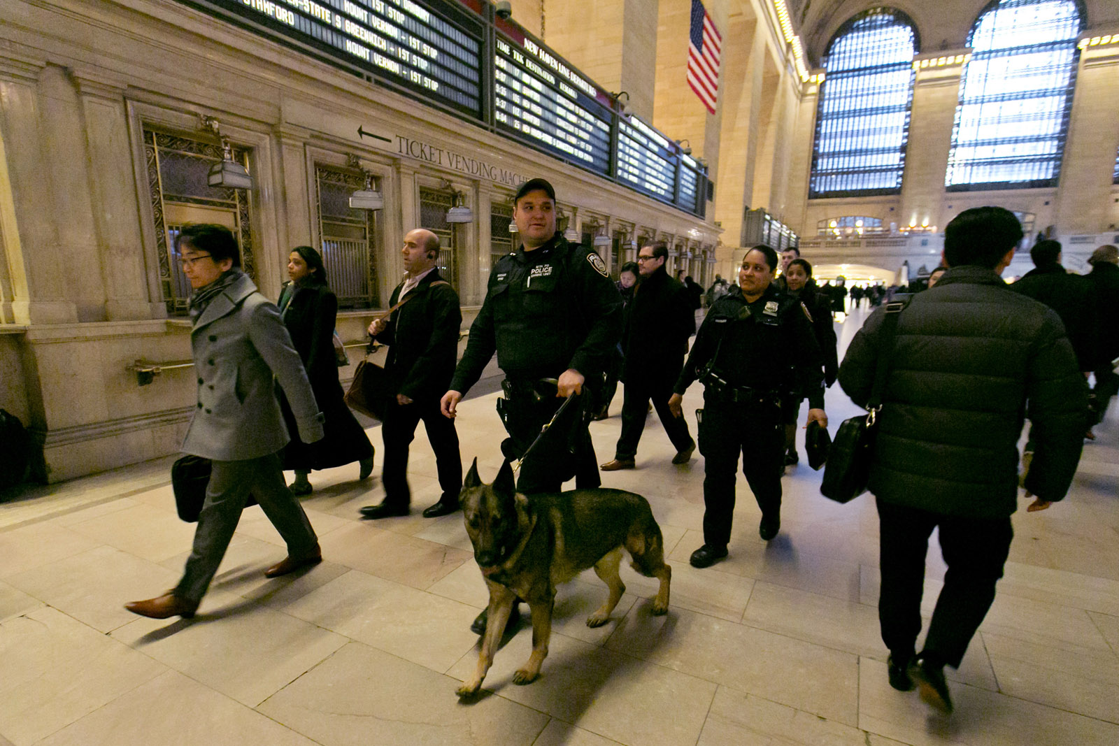 Metro-North Railroad police officers patrol Grand Central Terminal, in New York,  Tuesday, March 22, 2016. Authorities are increasing security throughout New York City following explosions at the airport and subway system in the Belgian capital of Brussels.  (AP Photo/Richard Drew)