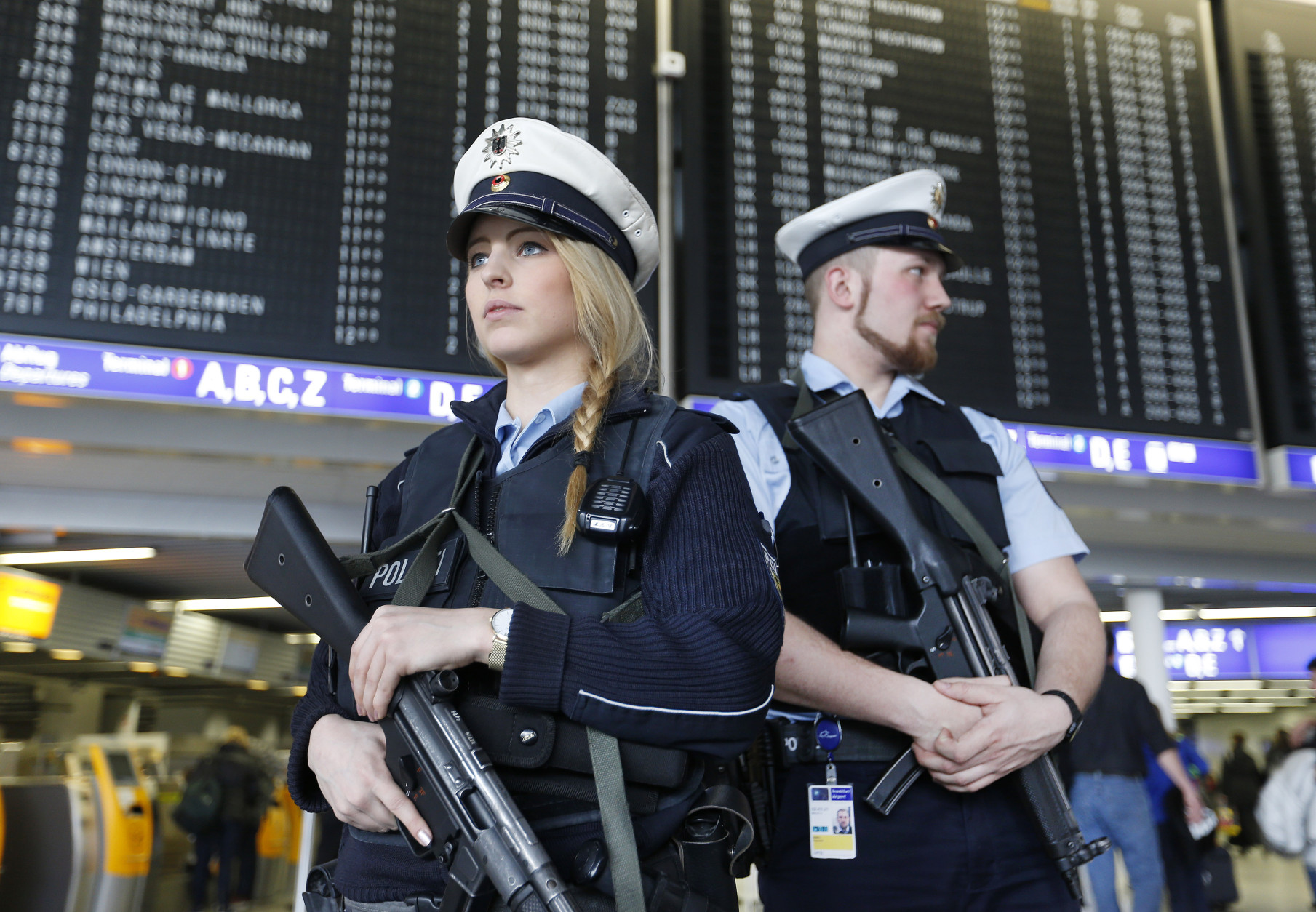 German police officers guard  a terminal of the airportthe  in Frankfurt, Germany, during tighter security measures  Tuesday, March 22, 2016, when various explosions hit the  Belgian capital  Brussels killing several people. (AP Photo/Michael Probst)