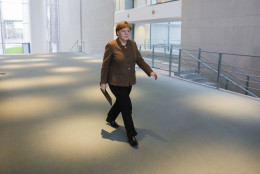 German Chancellor Angela Merkel arrives for a statement on the  attacks in Brussels at the chancellery in Berlin, Germany, Tuesday, March 22, 2016. (AP Photo/Markus Schreiber)