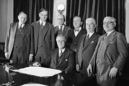 "President Franklin D. Roosevelt signed the Cullen-Harrison Act, or ""Beer Bill"", March 22, 1933, which will permit the sale of beer and wine containing 3.2% alcohol starting April 6.  He is seen with the Congressional sponsors of the bill, from left to right:  Representatives Claude V. Parsons of Illinois and John McCormack of Massachusetts; H.V. Hesselman, clerk in charge of enrolling bills; Representatives John Joseph O'Connor and Thomas Henry Cullen of New York; and Adolph Sabath of Illinois.  (AP Photo)"