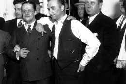 Gangster John Dillinger, center, strikes a pose with Lake County prosecuter Robert Estill, left, in the jail at Crown Point, Indiana, in 1934.  Dillinger is awaiting trial for the murder of police officer Willliam Patrick O'Malley when Dillinger robbed the First National Bank of East Chicago on Jan. 15, 1934.  (AP Photo)