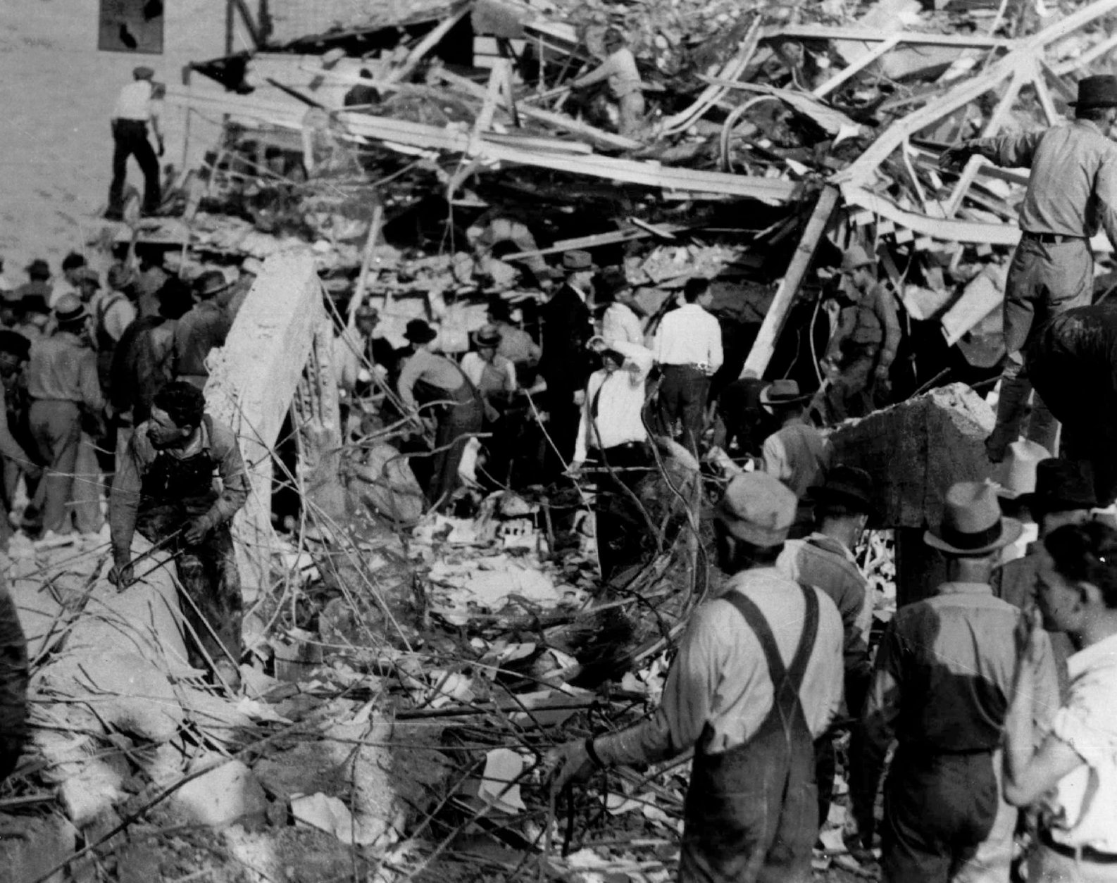 Rescue workers probe the twisted steel skeleton of the building of the Consolidated School in New London, Texas, which was demolished following a natural gas explosion March 17, 1937. Hundreds were killed in the disaster.  (AP Photo)