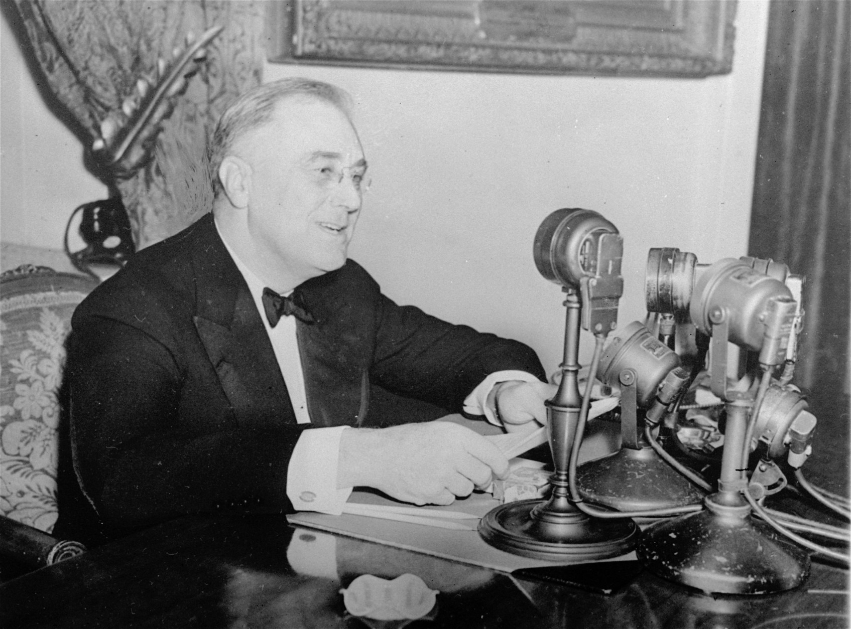 President Franklin D. Roosevelt talks to the nation in a fireside chat from the White House in this November 1937 photo.  FDR introduced his radio talks to explain administration policies and to appeal to the people for support for them during the difficult 1930's.  (AP Photo)